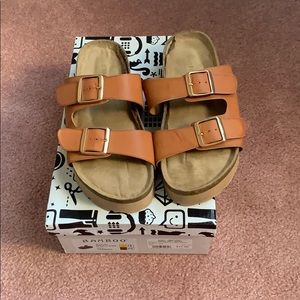 These sandals are by Bamboo.